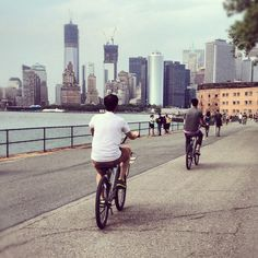 Bike riding on Governor's Island. View of Lower Manhattan. NYC.