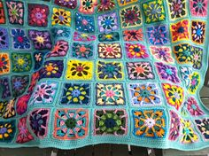 Crocheted afghan kaleidoscope granny squares multi-colored MADE TO ORDER. $100.00, via Etsy.