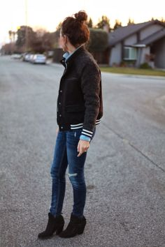 Transition into spring with a lightweight letterman style bomber jacket and suede booties.