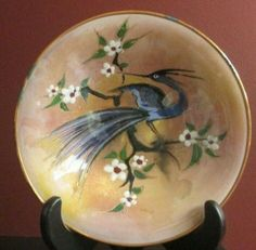 "Maker unknown, but it is signed by the artist and has a gold foil sticker which reads ""HANDPAINTED MADE IN HOLLAND"". Stork Bird, Enamel Dishes, Hand Carved, Hand Painted, Crane Bird, Cobalt Glass, Antique Plates, Heron, Home Decor Accessories"