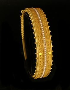 15 kt yellow gold seed pearl bracelet by Castellani, a firm that specialized in reproductions of ancient jewelry techniques.  Granulation (the small dots of gold) is a very difficult technique. The Etruscans were masters of granulation, and it took later jewelers a long time to figure out their methods.