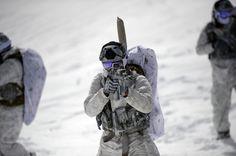 141209-N-FH305-1795  Navy SEALs demonstrate winter warfare capabilities.