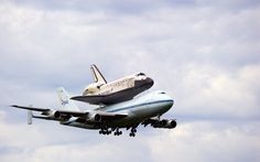 """Hitch-hiking Space Shuttle"" -- #wallpaper by ""chickenwire"" from http://interfacelift.com -- The Space Shuttle Discovery hitching a ride on one of NASA's Shuttle Carrier Aircraft (SCA), a heavily modified Boeing 747-100.  Landing at Dulles International Airport in Washington, D.C. after a low-altitude fly-over of the Washington Monument, White House, and United States Capitol building.  April 17th, 2012."