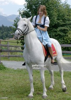Peaches Geldof rides on a lipizzan horse at the Stanglwirt Hotel on August 23, 2010 in Going, Austria. IT-Girl Peaches, daughter of singer Bob Geldof, came to Tyrol for a photo session at the Bio-Hotel Stanglwirt. The traditional dress of owner Maria Hauser fascinated her and she wanted to wear for this picture on a white lipizzan horse in front of the 'Wilder Kaiser' mountain the traditional 'Weisswurst-Party' Dirndl.  |  S❤
