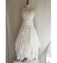 Wedding Dress Fairy Tattered Romantic Dress by cutrag, $301.01 minus the lacing in front and straps. That's kinda the idea I trying to run with