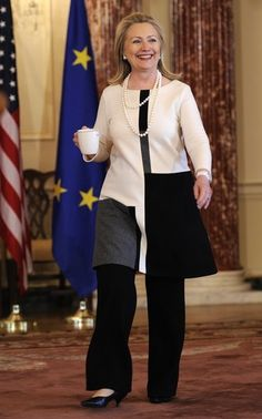 U.S. Secretary of State Hillary Clinton carries a cup as she arrives to discuss the just-concluded G-8 Foreign Ministers Meeting, at the State Dept. in Washington DC, April 12, 2012. [Reuters Pictures]