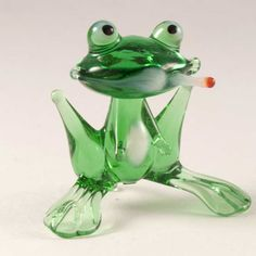 Glass Frog with Cigar Figurine is a hand-blown glass figurine which is made by the Russian. http://russian-crafts.com/glass-figurines/glass-reptiles/glass-frog-with-cigar.html