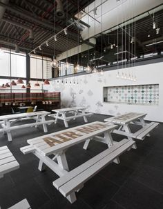 Love the idea of picnic tables for seating in the kitchen/café area.