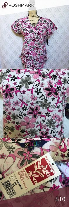 """Floral Breast Cancer Awareness Ribbon Scrub Top Floral Breast Cancer Awareness Ribbon V-Neck Scrub Top.       Measurements Laying Flat Size 🔹 XS Armpit to Armpit 🔹21"""" Shoulder to Hem 🔹26"""" Bundle to Save 🤓 Sorry NO outside transactions 🚫 NO trades 🚫 Reasonable Offers welcomed 👍 NO Low balling 👎 NO modeling 👎 NO Holds👎 All items from a pet 😼and Smoke Free Home  Happy Poshing 🤗 Zikit Tops"""