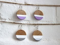DIY Paint-Dipped Wood Earrings >> http://blog.diynetwork.com/maderemade/how-to/diy-paint-dipped-wooden-earrings/?soc=pinterest