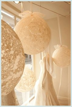 Hanging Tulle/lace/textures fabric covered balloons. I LOVE. So unique! I can picture hanging from beams
