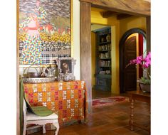 Fabric collage by Ft Worth artist Ken Blasingame and antique Mexican doors leading to master bedroom
