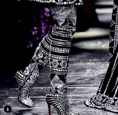 Custom boots for Naeem Khan Fall 2016. Designed in collaboration with @louboutinworld.Sterling silver on velvet.
