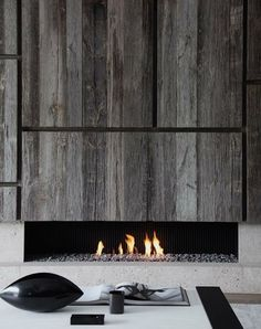 Reclaimed timber wall and open fire.