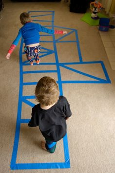 Painter's Tape Jumping Course / Agility Ladder. They've been at it all morning.