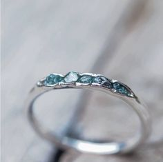 Hidden raw diamond ring, sterling silver, blue diamonds - dainty stacking ring by GardensOfTheSun on Etsy https://www.etsy.com/listing/178685229/hidden-raw-diamond-ring-sterling-silver