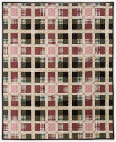 """Tartan Series: MacLaughlan quilt by Lori Mason. This quilt was made from up cycled plaid shirts and was inspired by the MacLachlan Clan tartan pattern. 76""""x63"""". Cotton"""