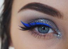 Blue eyeliner, silver eye make up. New Years make up inspiration.
