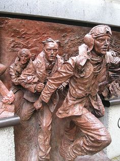 The Battle of Britain Memorial (detail of pilots) stands on the Embankment, close to Westminster Bridge in London