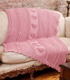 """Aran Hearts Throw Free Patern byBonnie Barker–""""If you need a wedding or anniversary gift, or just want someone to know how special they are on Valentine's Day or their birthday, this beautiful throw is the perfect choice. Four interesting crochet pattern stitches are used, including Popcorn Hearts"""" DownloadAran Hearts Throw Pattern"""