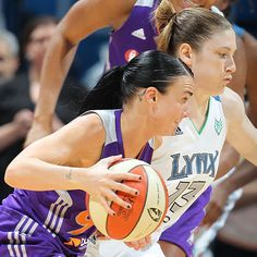 Samantha Prahalis of the Phoenix Mercury dribbles the ball against Lindsay Whalen of the Minnesota Lynx on June 27, 2012 at Target Center in Minneapolis, MN. (Photo by David Sherman/NBAE/Getty Images)
