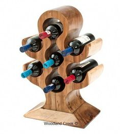 This beautiful wood wine bottle rack is hand carved shaped and sanded from an e Wood Wine Bottle Holder, Wood Wine Racks, Wood Log Crafts, Organic Wine, Wine Baskets, Wine Decor, Woodworking Projects, Carving, Hand Carved