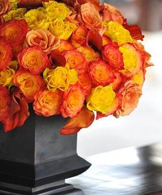 Brilliant orange and yellow rose centerpiece by Preston Bailey