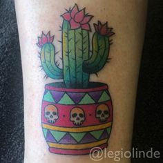 Traditional Cactus With Skulls In Pot Tattoo