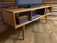 Mid century modern TV stand/entertainment console, quartersawn white oak with tapered wood legs.