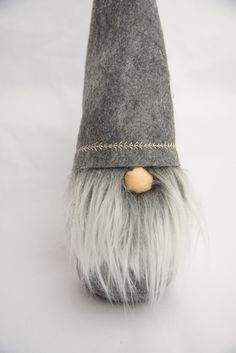 This adorable handmade felt gnome or tomte would make the perfect addition to your home or Christmas decor. Hats are embroidered with a fun design in a contrasting color & are available in red, Aqua, light gray and black. Gnomes come in 3 sizes, small, medium and large. You may select the size and hat color at check out. The body color will match the hat. When selecting the hat color and embroidery, the hot color is listed first, thread color second, so Aqua with red would be an aqua hat…