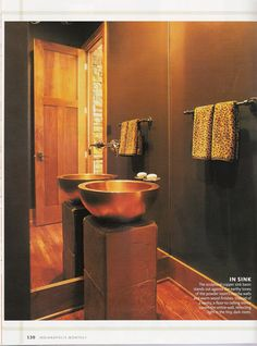 Hammered copper pedestal sink.