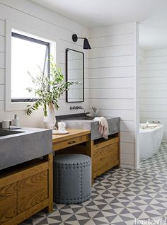 Concrete sinks, natural wood cabinets, white walls and geometric grey tiles | Mix and Chic
