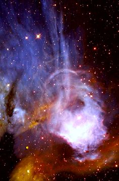 This image from NASA's Hubble Space Telescope has captured softly glowing filaments streaming from hot young stars in a nearby nebula. The image, presented by the Hubble Heritage Project, was taken in 1996 by Hubble's Wide Field and Planetary Camera 2, designed and built by NASA's Jet Propulsion Laboratory, Pasadena, Calif.