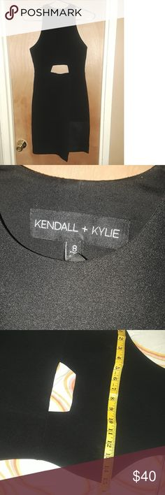 """Kendall and Kylie cut out dress This black cut out dress is in great shapedress is in great condition....its a very sexy party dress. This dress runs small, not at all for a  busty chic, the tag says 8 but in my opinion fits like a 4. Took pictures of measurements. Dress is 21"""" long from the waist. Really nice dress Kendall & Kylie Dresses Mini"""