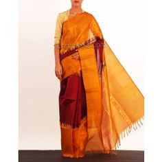 'Maroon and yellow color Dharmavaram handloom silk by cotton saree with matching maroon blouse.This plain silk by cotton sari has got zari woven temple style border, yellow borders on either side. And it has zari woven yellow elegant designer pallu.It is suitable for party and wedding wear'