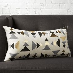 Tonal triangles in black and grey point in a modern direction to metallic gold foil. Digitally printed on a natural field of cotton/linen, oblong pillow reverses to solid grey cotton. Cowhide Pillows, Wool Pillows, Accent Pillows, Throw Pillows, Black And White Pillows, Living Room Shelves, Leather Pillow, Soft Seating, Soft Furnishings