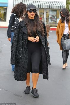 Low-key: The reality star kept her cool behind shades, hat and a dark outfit that consisted of a textured faux fur coat and bodysuit