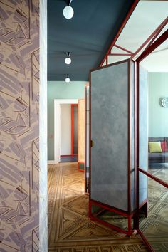The corridor is delimited by an iron structure, tinted glass and Venetian stucco panels, sheltering the storage space.  An idea custom-designed by Marcante-Testa and realized by Materia Design and the Turinese from Om Project.  Lamps (Atelier Areti).