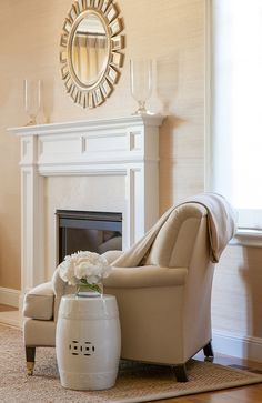 Grant K. Gibson - living rooms - rafia wallpaper, woven wallpaper, textured wallpaper, linen armchair, english rolled arm chair, linen english rolled arm chair, glass sunburst mirror, round silver leafed mirror, round silver leafed sunburst mirror, mirror over mantle, mirror over fireplace, glass hurricanes, white fireplace, traditional white fireplace, stone fireplace surround, sisal rug, bound sisal rug, ceramic garden stool, white garden stool, neutral living room, monochromatic living…