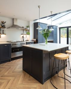 This fabulous kitchen is painted in RAL a deep blue and grey tone that suits any contemporary style. Complimented by the hard wearing white quartz worktops this wonderful kitchen will provide many years of beauty and functionality. Kitchen Diner Extension, Open Plan Kitchen Diner, Open Plan Kitchen Living Room, Kitchen Dining Living, Home Decor Kitchen, New Kitchen, Kitchen Ideas, Modern Shaker Kitchen, Shaker Style Kitchens