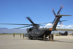 The blades of German Air Force CH-53GS begin to spin before being boarded by German and U.S. Air Force pararescuemen during Angel Thunder 2015 at Davis-Monthan Air Force Base, Ariz., June 7, 2015. Angel Thunder is the world's largest personnel recovery exercise. D-M hosted 11 partner nations and nine interagencies with a common goal to train personnel recovery forces to prepare, plan, execute and adapt for rescue missions. (U.S. Air Force photo by Airman 1st Class Chris Massey/Released)