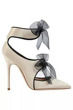 Cream & black high heeled shoe