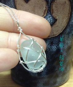 White sea glass pendant silver braided twine