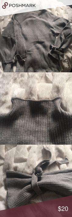 "Forever 21 Grey Sweater This fun and chic sweater with 🎀 accents on the wrists is a great staple to cooler weather. I bought this at Forever 21 but the tags say the brand is ""very J"". Forever 21 Sweaters Cowl & Turtlenecks"