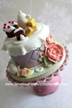 I made this small tea party themed cake for a Macmillian coffee morning event as a raffle prize. I am making a Youtube video on the flowers, so please do subscribe to my channel to get updates of all my tutorials :) Thanks...