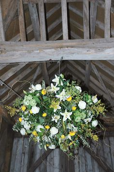 Large hanging floral display for a barn. Yellow flowers. Photo by Tamsyn Hayward Photography