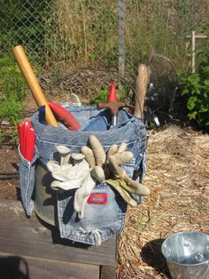 Add pockets from old jeans to a bucket to organize garden tools. Instead of throwing away your old jeans, use most of those old pants to make a tool belt to strap around a bucket. Make this without buying any new materials, and customize your pockets depending on what tools you like to use.