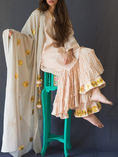 Size Chart  - These are body measurements Length of kurta is 32 inches, Length of sharara is 38 inches. XS - Chest : 32.5, Waist : 26, Hip : 35, Shoulder : 14,