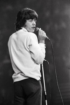 Lead singer of the Rolling Stones Mick Jagger performing on stage 11th April 1965