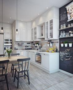 Białe szafki w małej kuchni z jadalnią